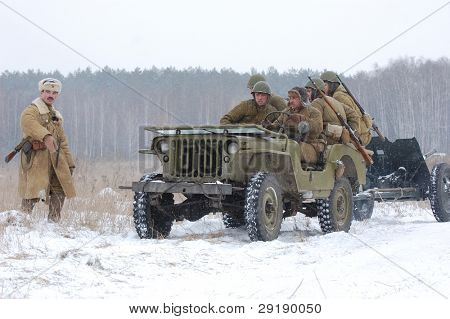 KIEV, UKRAINE - FEB 20: Members of military history club RedStar wear historical Soviet uniform during historical reenactment of WWII, February 20, 2011 in Kiev, Ukraine