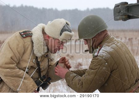 KIEV, UKRAINE - FEB 20: Members of military history club RedStar wear historical Soviet uniform during historical reenactment of WWII on February 20, 2011 in Kiev, Ukraine