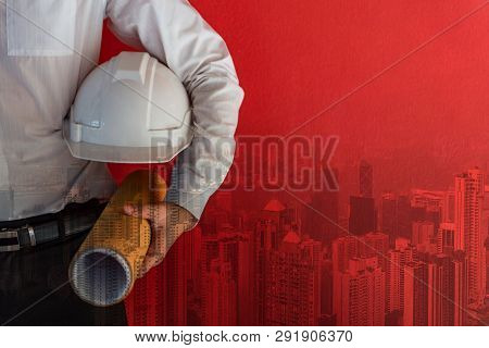 Double Exposure Of Male Civil Engineer Holding Protective Safety Helmet And Architectural Drawing Ne