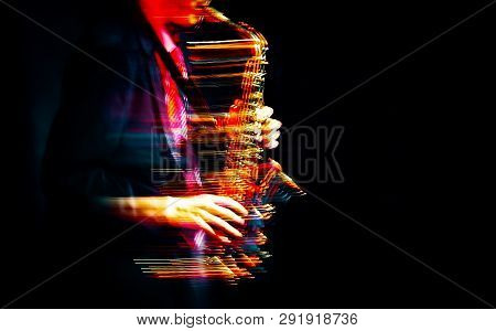 Saxophone Player Performing On Stage
