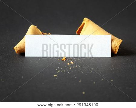 An image of a fortune cookie with a blank paper for your message