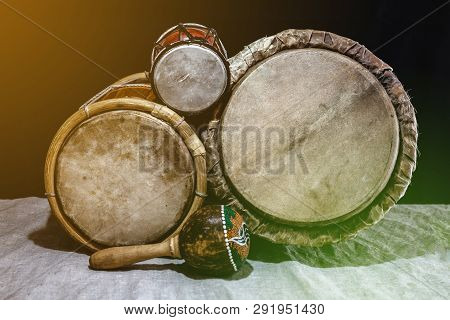Music Background With Ethnic Percussion Musical Instruments, Drums Of Different Sizes, With Color Fi