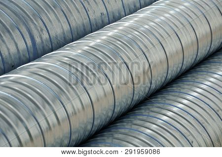 Alu Pipes For Ventilation Stacked At Construction Site