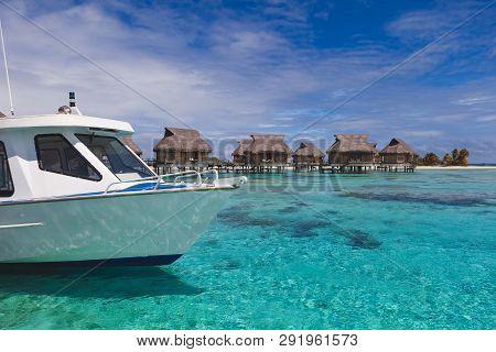 Boat Arrives At Tropical Resort Paradise In Tahiti