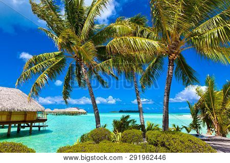 Overwater Bungalows In Tropical Island Paradise Of Bora Bora, Tahiti