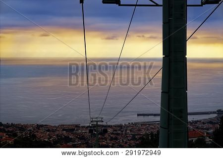 Cables Of A Funicular From Monte To Funchal At Sunset. Portuguese Island Of Madeira