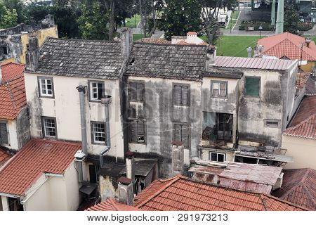 Exterior Of An Old Abandoned Building In The Midst Of A Residential District. Portuguese Island Of M