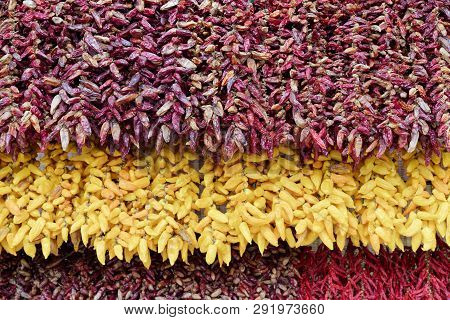 Full Frame Shot Of Hanging Red And Yellow Chili Peppers Bunches