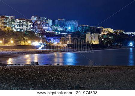 Panoramic View At A Beach Praia Formosa At Night. Funchal, Portuguese Island Of Madeira