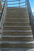 Stairs with handrails against sky and mountain poster