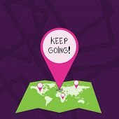 Text sign showing Keep Going. Conceptual photo make effort to live normally in spite of difficulty situation Colorful Huge Location Marker Pin Pointing to an Area or GPS Address on Map. poster