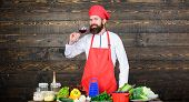 Man master chef hold glass of wine. Which wine serve with dinner. Exquisite dinner concept. Wine degustation. How to match wine and food like expert. Hipster wear hat and apron enjoy aroma of drink poster
