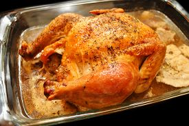 Large Roasted Chicken In A Baking Pan