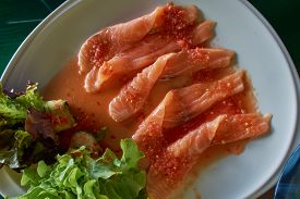 Some Strip Raw Salmon In Spicy Sauce