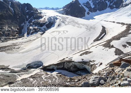 Glacier Taschachferner With Glacier Mouth And Mountain Snow Panorama In Tyrol Alps, Austria