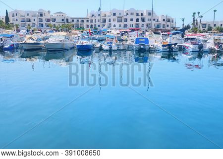 Yachts And Boats At The Pier On The Background Of White Arabic House At The Blue Water, Copy Space,