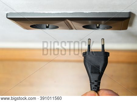 Close Up Power Plug Plugged Into Electric Socket