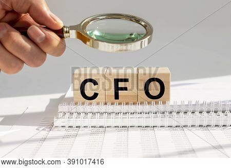 Cfo Acronym Built With Letter Cubes On Office Table, Searching For Chief Financial Officer Concept