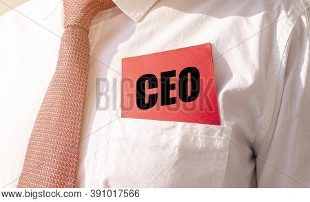 Ceo Acronym, Chief Executive Officer Text Inscription On Red Paper Note In Pocket Of White Shirt Of
