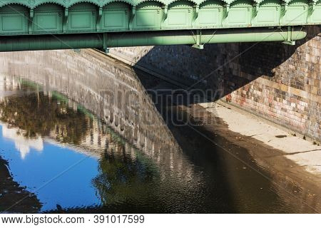 green iron bridge over the river