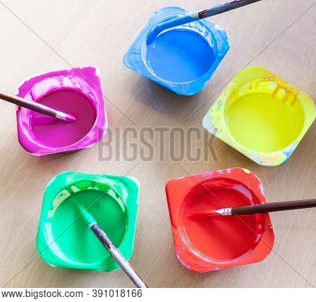 Washable Tempera And Rounded Paint Brushes. Yogurt Cups Reused As Paint Containers