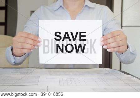 Auto Insurance Concept. Business Woman Is Holding Notepad With Text Save Now. The Words Are Now Bein