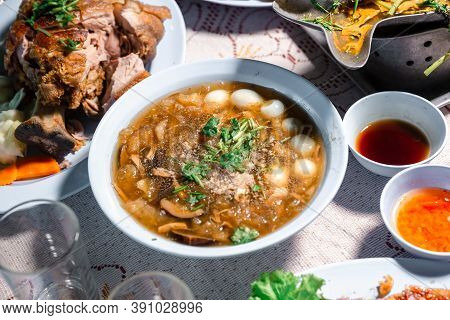 Chinese Style Soup; Or Braised Fish Maw In Red Gravy With Eggs, Mushroom, And Bamboo Shoot In White