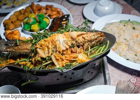 Snakehead With Dressing.  Steamed Whole Fish With Sauce. Steamed Whole Fish With Sauce And With Dres
