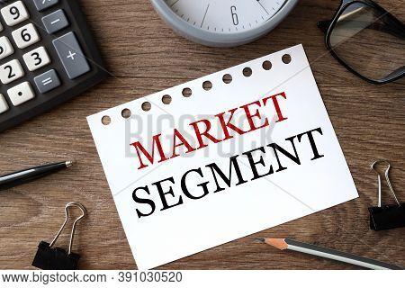 Market Segment, Text On White Paper On Wood Background