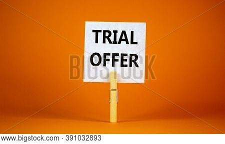 White Paper With Text 'trial Offer', Clip On Wood Clothespin. Beautiful Orange Background. Business