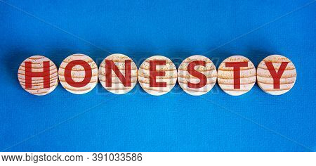Honesty Word Written On Wood Circles. Honesty Text On Table, Business Concept. Beautiful Blue Backgr