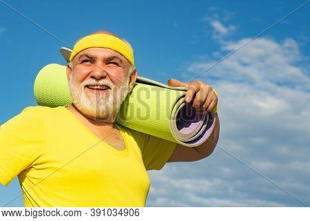 Grandfather Sportsman. Energetic For Elderly Sportsmen. Senior Male Is Enjoying Sporty Lifestyle. Yo