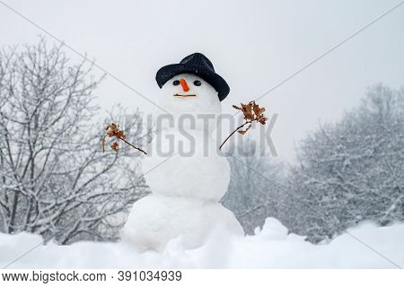 New Year Christmas Concept. Snowman Outdoor. Happy Smiling Snow Man On Sunny Winter Day. Cute Little