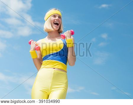 Successful Attractive Sportswoman With Bright Smile Wearing Yellow With Blue Training Uniform Demons