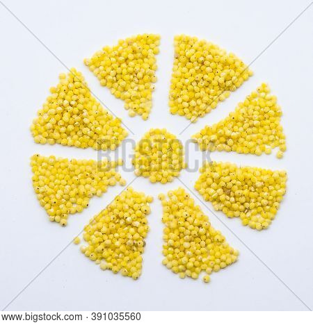 Millet Porridge, Millet Groats On A White Background, Snowflake From Millet Grains, Flower From Cere