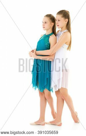 Pretty Gymnasts Performing Rhythmic Gymnastics Exercise, Two Beautiful Teen Sisters Dancing Wearing