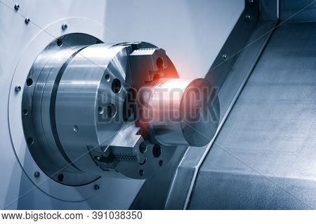 Cnc Lathe Machine Or Turning Machine With Rotating Spindle With Metal Part  Industrial Engineering C