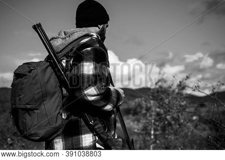 Illegal Hunting Poacher In The Forest. Hunter With Shotgun Gun On Hunt. American Hunting Rifles. Gun