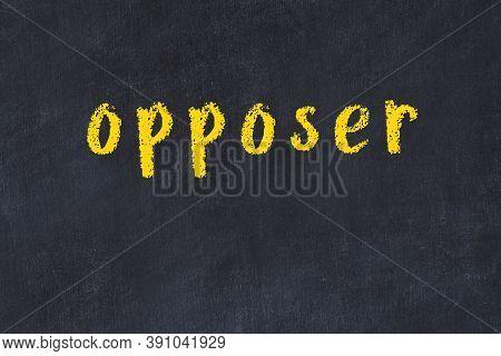 Chalk Handwritten Inscription Opposer On Black Desk