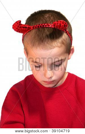 Little Devil Boy With Bowed Head