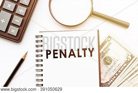 Penalty Text On White Notepad On Office Background.