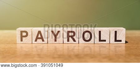 Wooden Blocks With The Text: Payroll. Business Concept