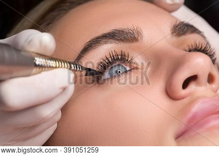 Permanent Eye Makeup Close Up Shot. Cosmetologist Applying Tattooing Of Eyes. Makeup Eyeliner Proced