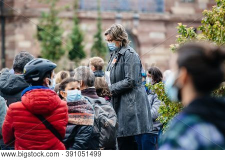 Strasbourg, France - Oct19, 2020: Woman Looking From Above At Place Kleber Pay Tribute To History Te