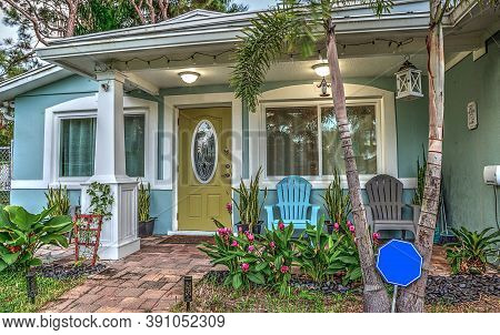 Blue And Green Beach Bungalow Porch In Tropical Naples, Florida