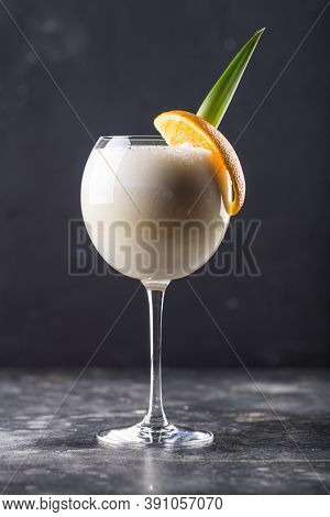 Refreshing Alcohol Cocktail Pina Colada In Glass Placed On Table. High Quality Photo