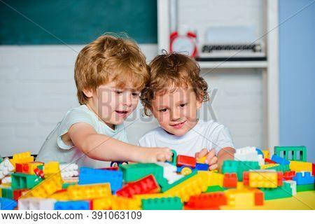 Children Study In Preschool. Cute Little Preschool Kids Boys Pupils In A Classroom At School. Happy