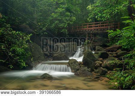 A Beautiful Waterfall Deep In The Tropical Forest In Thailand
