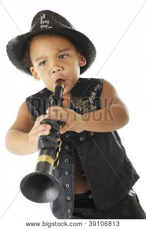 An adorable, intense preschool clarinetist in a sparkly fedora and black leather vest.  On a white background.