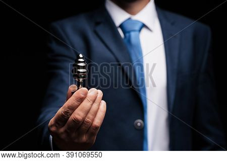 Man In A Suit Holds An Anal Plug In His Hand For Sex